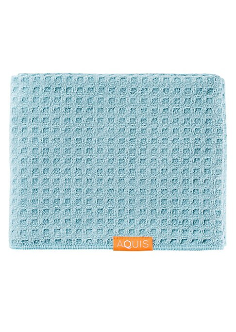Image of With increased surface area from the layered fabric, the AQUIS Waffle Luxe Long Hair Towel is an ultra-absorbent layered waffle texture with 25% more length. It is designed for longer hair lengths and for thick, coarse, and porous hair. Made with AQUITEX,