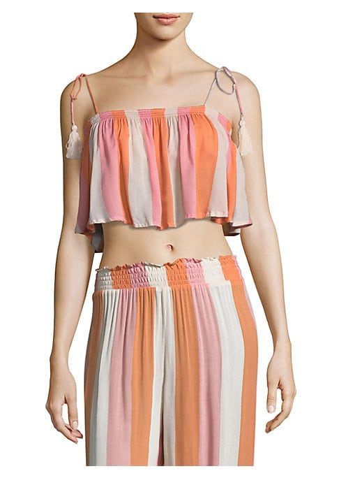 """Image of Colorful striped top in cropped silhouette. Straight neckline. Sleeveless. Shoulder tie detail. Pullover style. About 15"""" from shoulder to hem. Cotton. Hand wash. Imported. Model shown is 5'10"""" (177cm) wearing US size Small."""
