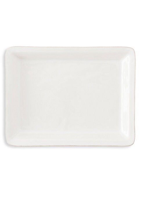 "Image of Round ceramic tray crafted to carry various plates. Diameter, 16"".Ceramic stoneware. Dishwasher, freezer, microwave and oven safe. Imported."