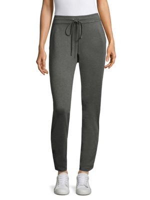 "Image of Ankle cut jogging pants. Banded waist with drawstring. Side slit pockets. Rise, about 16"".Inseam, about 28.5"".Leg opening, about 12"".Rayon/nylon/elastane. Dry clean. Made in USA. Model shown is 5'10"" (177 cm) wearing US size small."