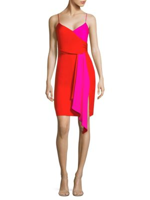 """Image of Silk stretch wrap dress with ruffle sash detail.V-neck. Sleeveless. Spaghetti straps. Side zip close. Waist ruffle sash. Vented hem. About 40"""" from shoulder to hem. Silk/elastane. Dry clean. Made in USA. Model shown is 5'10"""" (177cm) wearing a US size 4."""