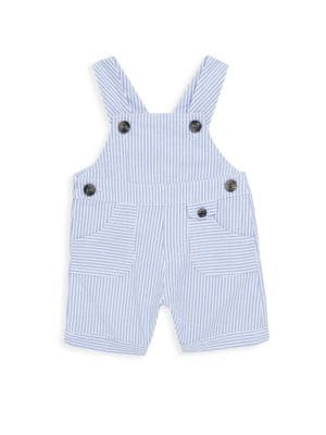 Image of Sweet striped overalls with pockets and buttons. Buttoned shoulder straps. Button sides. Front buttoned coin pocket. Front patch pockets. Front buttoned coin pocket. Back button flap pocket. Cotton. Machine wash. Imported.