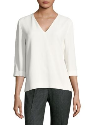 "Image of Crepe-woven blouse.V-neck. Elbow sleeves. Concealed back zip closure. Vented hem. Lined. About 24.5"" from shoulder to hem. Acetate/viscose. Dry clean. Imported of Italian fabric. Model shown is 5'10"" (177cm) wearing US size 4."