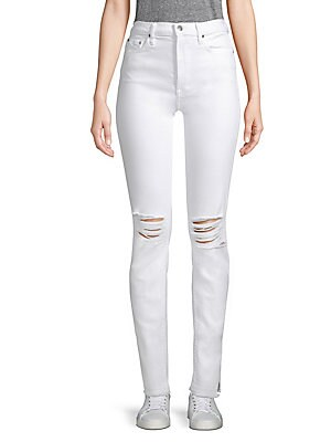 "Image of Skinny button-fly jeans with knee distressing and side slit hems. Belt loops Button fly with button closure Five-pocket style Cotton/spandex Machine wash Made in USA of imported fabric SIZE & FIT Skinny leg Rise, about 9"" Inseam, about 32.5"" Leg circumfer"