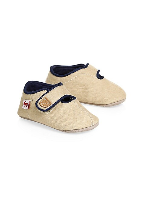 Image of Soft, flexible crib shoe in classic khaki denim. Denim upper. Closed toe. Grip tape closure. Canvas lining. Suede outsole with non-skid dot texture. Imported.