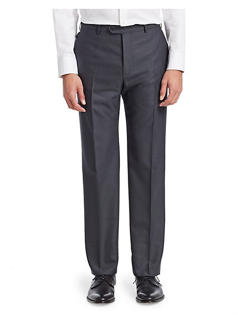 "Image of Office essential pants tailored from wool fabric. Belt loops. Button closure. Side slip pockets. Back buttoned pockets. Rise, about 14"".Inseam, about 34"".Wool. Dry clean. Made in Italy."