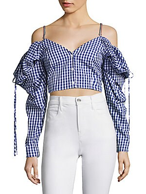 """Image of Cropped off-the-shoulder top in checked print Off-the-shoulder V-neck Long sleeves Button-front About 7"""" from shoulder to hem Cotton Dry clean Made in USA Model shown is 5'10 (177cm) wearing US size 4. Contemporary Sp - Trend. Petersyn. Color: Indigo. Siz"""