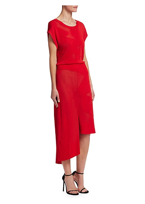 """Image of Sheer details offer elegance to dress. Roundneck. Short cape sleeves. Button back. Banded waist. Asymmetric step hem. Front vent. Exposed seams. About 55"""" from shoulder to hem at longest point. Viscose. Dry clean. Imported. Model shown is 5'10"""" (177cm) we"""