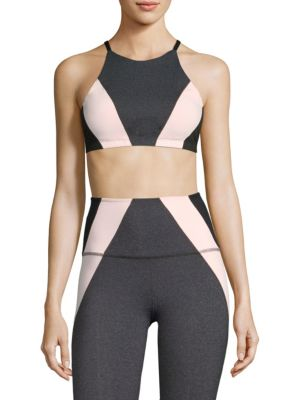 "Image of Colorblock sports bra updated with halter straps. Adjustable halter straps. Pullover style. Nylon/polyester/spandex. Dry clean. Imported. Model shown is 5'10"" (177cm) wearing US size Small."
