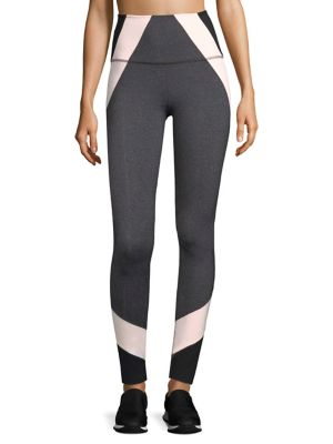 """Image of High-waisted leggings with colorblock details. Banded waist. Rise, about 10"""".Inseam, about 27"""".Nylon/polyester/spandex. Dry clean. Imported. Model shown is 5'10"""" (177cm) wearing US size Small."""