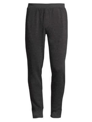 "Image of Essential sweatpants tailored from cotton-blend fabric. Banded waist. Side slip pockets. Back patch pockets. Banded cuffs. Rise, about 11"".Inseam, about 33"".Leg opening, about 11"".Cotton/polyester. Machine wash. Imported."