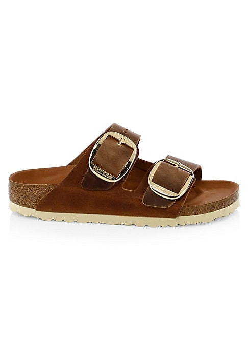 Image of Comfy sandals crafted with a cork heel and buckles. Leather upper. Leather trim. Open toe. Slip-on style. Ethylene-vinyl acetate sole. Imported.