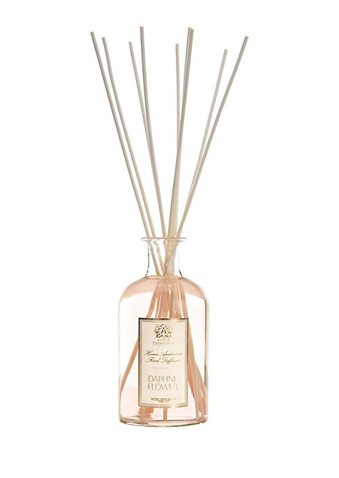 Image of From the Daphne Flower Collection. Utilizing apothecary bottles filled with exquisite fragrance, the reeds absorb the fragrance and subtly distribute throughout the air, providing a lasting, constant and beautiful scent. A bright floral fragrance inspired