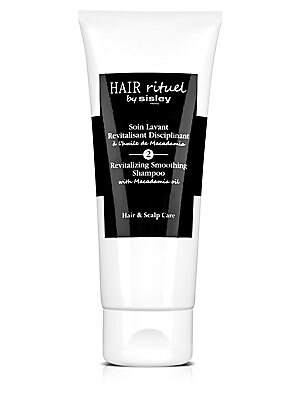 Image of Smoothing shampoo designed to envelop the hair. The Revitalizing Smoothing Shampoo with Macadamia oil gently cleanses while providing the necessary vitamins and minerals for the vitality of the scalp and the hair. Its formula benefits from a combination o