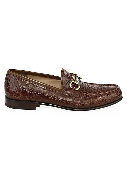Image of Iconic crocodile-embossed detail adds texture to leather loafers. Leather upper. Round toe. Slip-on style. Leather lining and sole. Made in Italy.