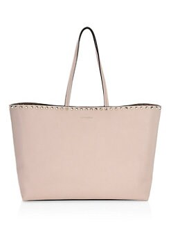 af296b309cc0 Product image. QUICK VIEW. Valentino Garavani. Rockstud Grained Leather  Tote Bag