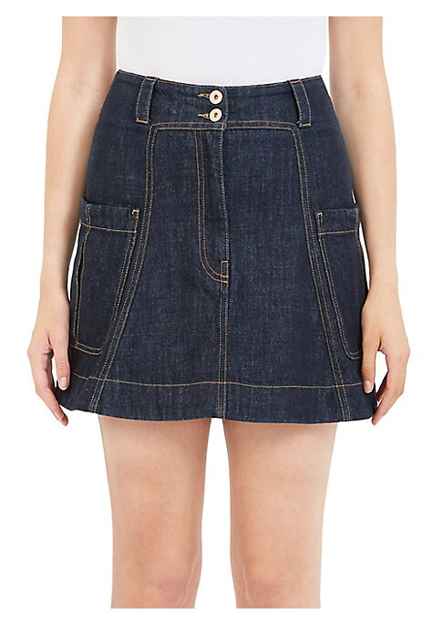 "Image of Denim mini skirt with bold stitching. Belt loops. Side patch pockets. Back button welt pocket. About 27"" long. Cotton. Dry clean. Imported. Model shown is 5'10"" (177cm) wearing US size 4."