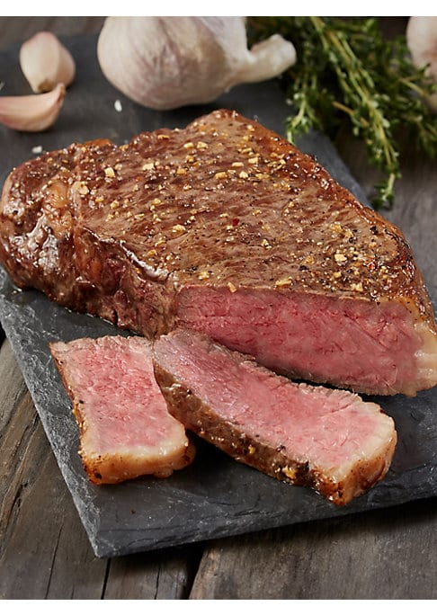 Image of EXCLUSIVELY AT SAKS FIFTH AVENUE.A fantastic assortment that provides a variety of choices of steak and meat to enjoy and a cheesecake to complete the meal. Includes: Two pieces of prime rib-eye steak, Two 6oz Premium Angus Beef Filet Mignons, Two 8oz Pre
