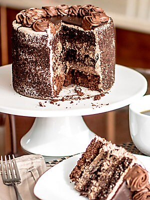 Image of Indulge in all things chocolate with this death by chocolate cake. Built atop a walnut brownie base, this chocolate work of art is layered with chocolate mousse filling and chocolate cake and is sure to please any chocolate connoisseur. 6 Inch cake Serves