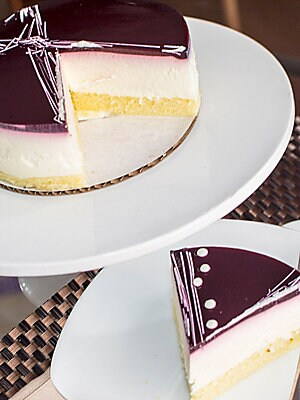 Image of Made from a plain yogurt mousse and vanilla cake this artistic creation is topped with a delicious blackberry glaze Allergen Warning: Processed in a facility that uses tree nuts and peanuts 6 Inch cake Serves 5-6 people Made in USA. Drop Ship Prgrm - Food
