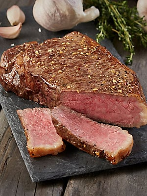 Image of This combination of oh so tender Filet Mignon cuts and Hearty Boneless Strips is the perfect combination for a special dinner or a thoughtful gift. These steaks available for a limited time only. Order yours today and experience exquisite steaks that defi