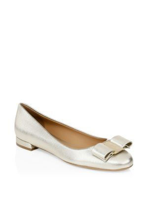 Varina Gold Bow Leather Flats by Salvatore Ferragamo