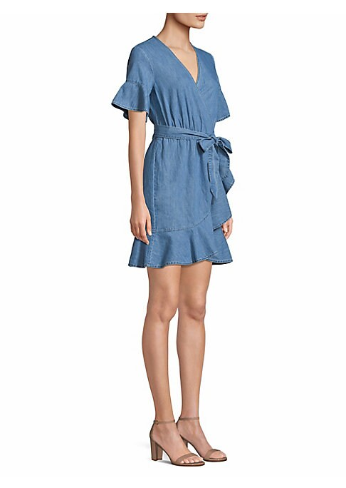 "Image of Chambray wrap dress with asymmetric ruffle detailing.V-neck. Short sleeves. Self-tie at waist. Pullover style. About 36"" from shoulder to hem. Cotton. Machine wash. Imported. Model shown is 5'10"" (177cm) wearing US size 4. ."