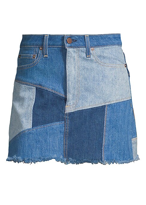 """Image of From the Saks It List: Luxe Denim. Denim mini skirt with patchwork design. Belt loops. Zip fly with button closure. Five-pocket style. Fringe hem. About 18"""" long. Cotton/elastane. Machine wash. Made in USA of Italian fabric. Model shown is 5'10"""" (177cm) w"""