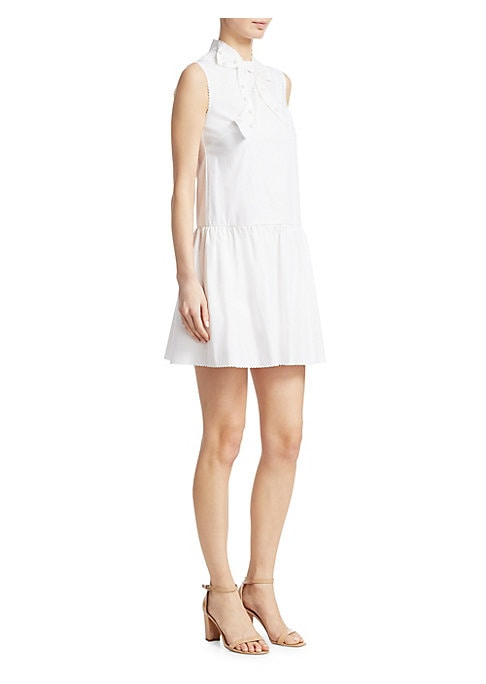 "Image of Cotton tie neck dress with scalloped edges. High neckline with tie detail. Sleeveless. Concealed back zip closure. About 34"" from shoulder to hem. Cotton/elastane. Dry clean. Made in Italy. Model shown is 5'10"" (177cm) wearing US size 4. ."