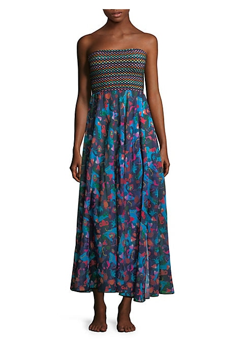 """Image of Smocked bodice anchors signature mixed print dress. Strapless neckline. Pullover style. Contrast bodice. Flounce skirt. About 48"""" from bust to hem. Rayon. Dry clean. Made in Italy. Model shown 5'10"""" (177cm) is wearing US size 4."""