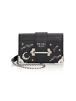 8c0b840622796f QUICK VIEW. Prada. Cahier Studded Leather Crossbody Bag