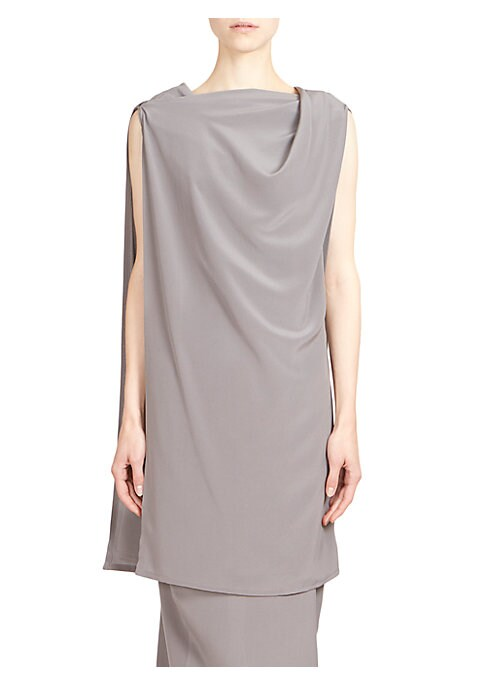 """Image of Toga tunic top crafted in luxe silk. Bateau neckline. Sleeveless. Pullover style. About 30"""" from shoulder to hem. Silk. Dry clean. Made in Italy. Model shown is 5'10"""" (177cm) wearing US size 4. ."""