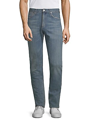 "Image of Faded aesthetic adds vintage flair to straight-leg jeans Belt loops Five-pocket style Zip fly with button closure Rise, about 10.25"" Inseam, about 33.5"" Leg circumference, about 15.5"" Cotton/elastane Dry clean Made in USA. Men Adv Contemp - Contemp Denim"