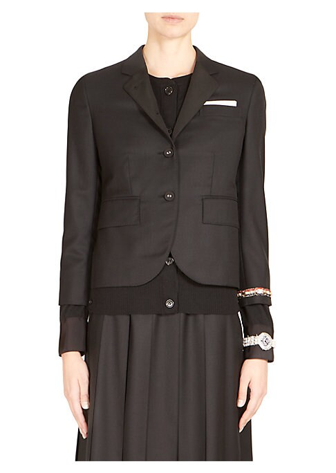 Image of Classic structured blazer in twill with wristwatch applique on elongated cuffs for a subtle burst of style. Notch lapels. Front button closure. Slip pocket at breast. Princess seams. Long sleeves with attached elongated button cuffs. Flap pockets at waist