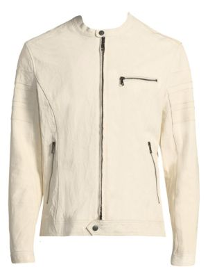 """Image of Studied details update soft leather moto jacket. Banded snap collar. Long sleeves. Zip cuffs. Two-way zip front. Snap hem. Chest and waist zip pockets. About 26"""" from shoulder to hem. Leather. Dry clean by leather specialist. Imported."""