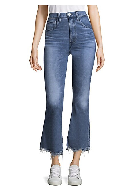 """Image of Cropped flare jeans finished with hand-distressed hems. Five-pocket style. Zip fly. Let down hems. Cotton/elastane. Machine wash. Made in USA. SIZE & FIT. Rise, about 11.5"""".Leg circumference, about 18"""".Inseam, about 27"""".Model shown is 5'10"""" (177cm) wearin"""