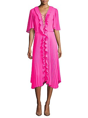 """Image of Cascading front ruffles elevate flirty pleated dress Lace-up plunging v-neck Short sleeves Concealed back zip Seamed waist About 42 from shoulder to hem Metal/polyester Dry clean Made in USA Model shown is 5'10"""" (177cm) and wearing US size Small. Contempo"""