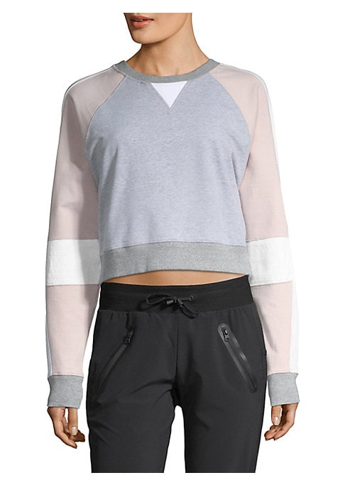 "Image of Colorblock eccentricities add geometric edge to sweatshirt. Crewneck. Long sleeves. Rib-knit at neck, cuffs and hem. Pullover style. About 19"" from shoulder to hem. Cotton/spandex. Machine wash. Imported. Model shown is 5'10"" (177cm) wearing US size Small"