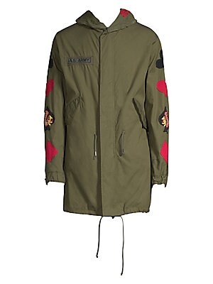 "Image of From the Saks IT LIST STATEMENT OUTERWEAR Yes, you need a new coat for every destination. Cotton-blend parka with allover embroidered design Attached drawstring hood Long sleeves Concealed front zip with snap closure Waist flap pockets Lined About 33"" fro"