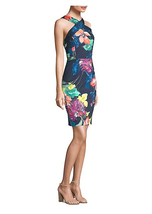 """Image of Form-fitting dress in colorful floral print. Crossover neckline. Sleeveless. Concealed back zip closure. About 42"""" from shoulder to hem. Polyester/spandex. Dry clean. Imported. Model shown is 5'10"""" (177cm) wearing US size 4. ."""