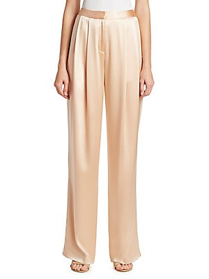 "Image of Lightweight pleat front pants in shimmering silk Seamless waist Zip fly with hook and eye closure Slip pockets at waist Back welt pockets Rise, about 12"" Inseam, about 30"" Silk Dry clean made in USA Model shown is 5'10 (177cm) wearing US size 4. Designer"