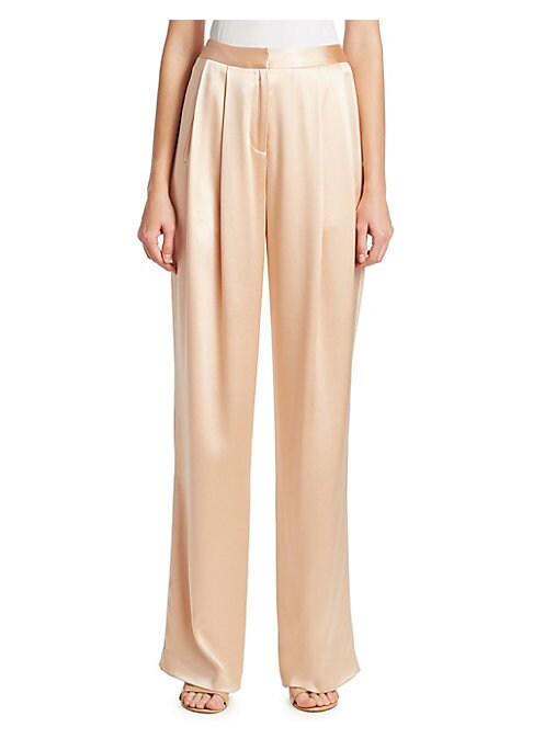 """Image of Lightweight pleat front pants in shimmering silk. Seamless waist. Zip fly with hook and eye closure. Slip pockets at waist. Back welt pockets. Rise, about 12"""".Inseam, about 30"""".Silk. Dry clean. made in USA. Model shown is 5'10"""" (177cm) wearing US size 4."""