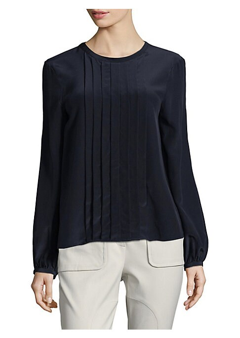"""Image of Casual silk blouse enhanced with pressed pleats detail. Roundneck. Long sleeves. Buttoned cuffs. Relaxed-fit. About 25"""" from shoulder to hem. Silk. Dry clean. Made in USA of imported fabric. Model shown is 5'10"""" (177cm) wearing US size 4."""