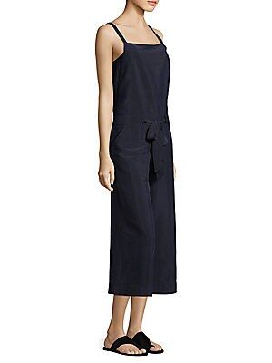 "Image of Cropped drawstring jumpsuit in wide-leg silhouette Squareneck Sleeveless Concealed side zip Drawstring waistband Relaxed-fit Lined About 51"" from shoulder to hem Rise, about 8"" Inseam, about 25"" Leg opening, about 12"" Cupro/elastomultiester Dry clean Made"