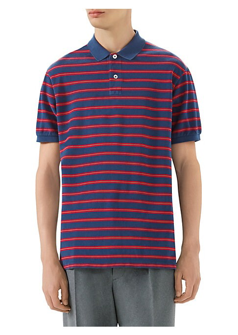 "Image of Dark blue, red, and green striped pique polo. Dark blue spread collar. Button-through placket with mother of pearl buttons. Short sleeves with elastic trim. Gucci label at back. About 27"" from shoulder to hem. Cotton. Dry clean. Made in Italy."