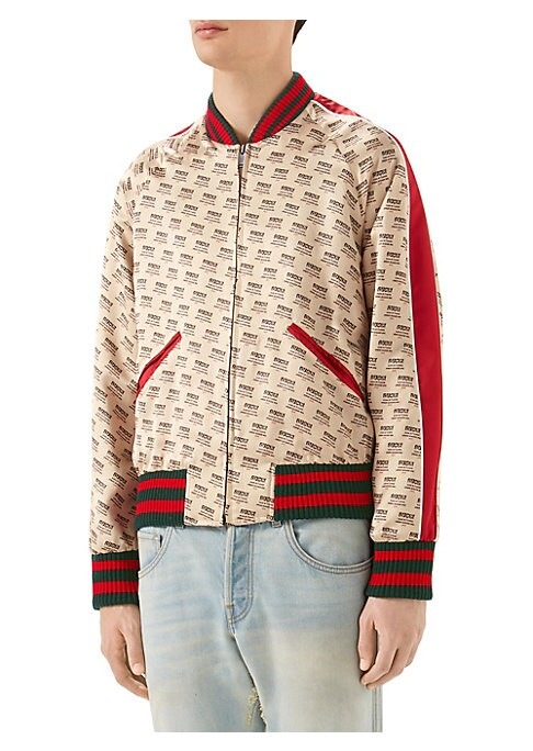 """Image of Gucci invite stamp print silk bomber jacket. Green and red knit trim. Baseball collar. Long sleeves. Front zip closure. Welt pockets. Gucci hypnotism invite stamp print at back. Blue silk lining.26"""" shoulder to hem. Silk. Dry clean. Made in Italy."""