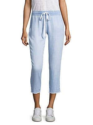 """Image of Cropped drawstring pants with frayed hem Elasticized drawstring waist On-seam pockets Rise, about 10"""" Inseam, about 25"""" Tencera Machine wash Made in USA Model shown is 5'10 (177cm) wearing US size 4. Contemporary Sp - Trend. Bella Dahl. Color: Laguna Blue"""