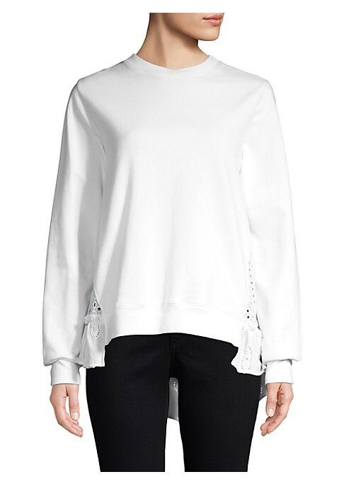 """Image of Cotton eyelet pullover with ruffle trim. Crewneck. Long sleeves. Asymmetric hem. Pullover style. About 25"""" from shoulder to hem. Cotton. Dry clean. Made in USA. Model shown is 5'10"""" (177cm) wearing US size 4. ."""