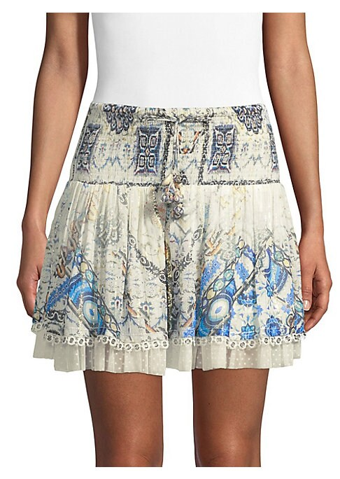 """Image of Woven printed mini skirt in front tie closure. Elasticized waist. Pull-on style. About 17"""" long. Viscose georgette. Dry clean. Imported. Model shown is 5'10"""" (177cm) wearing US size Small."""