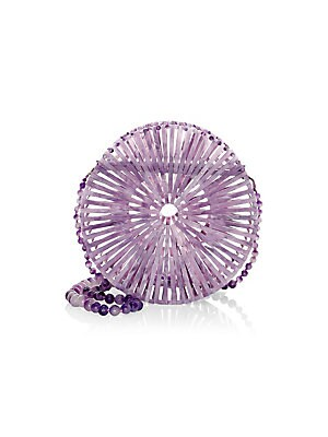 Image of Acrylic circle bag with removable stone beaded strap. Magnetic flap closure Acrylic Imported SIZE Removable stone beaded strap, 24 drop 8W x 8H x 3D. Handbags - Contemporary Handbags > Saks Fifth Avenue. Cult Gaia. Color: Lavender.